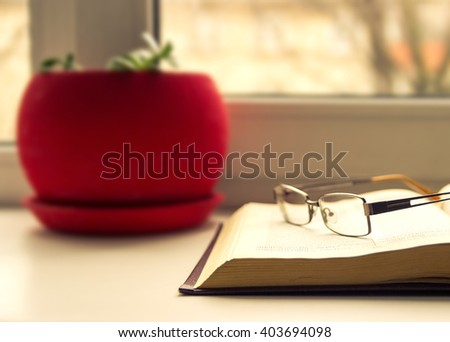Glasses and books - classy attribute of intelligence. Reading, learning  - stock photo