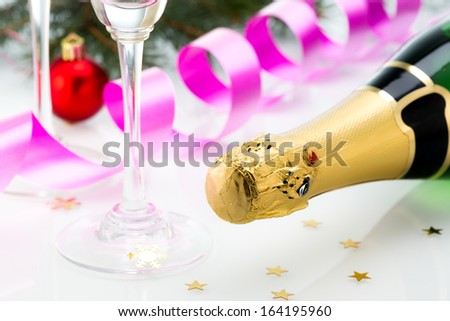 Glasses and bottle of champagne, serpentine  isolated on a white background. Celebration. New Year Card Design with Champagne. Christmas Scene.  - stock photo