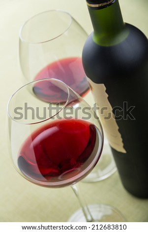 Glasses and bottle of red wine - stock photo
