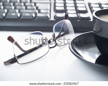 Glasses and cup of coffee on a table