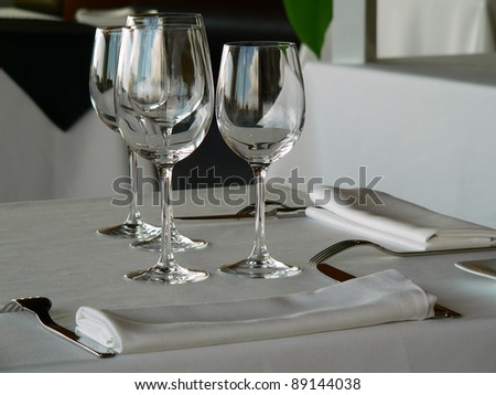 glasses and cuttlety on a table in a restaurant