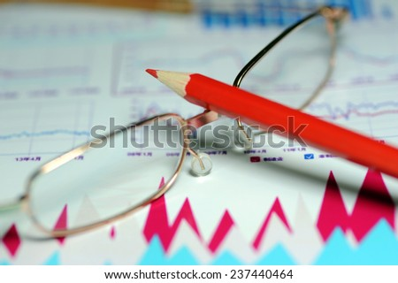 Glasses and data charts, business concept analysis - stock photo