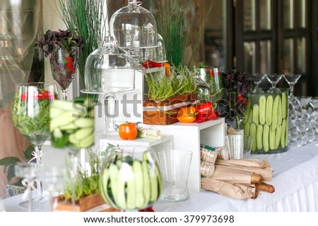 Glasses and food decor on the wedding table in restaurant - stock photo