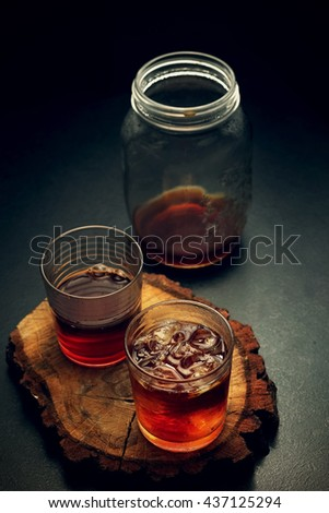 Glasses and jar of filter coffee on a wooden board. Toned image