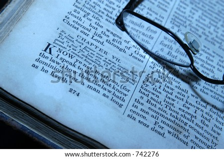glasses and old bible