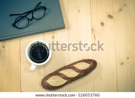 glasses ,book,coffee and bread object concept