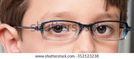 glasses boy in the foreground