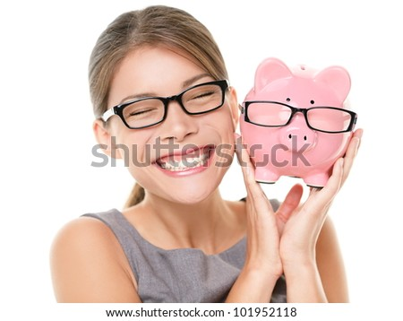 Glasses eyewear savings piggybank. Woman happy excited over saving money buying glasses. Young beautiful multiracial Caucasian / Chinese Asian woman isolated on white background. - stock photo