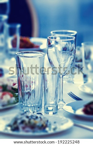 Glasses for drinks and cocktails at the festive table. toned - stock photo