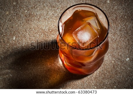 glasses from whiskey on a marble table - stock photo