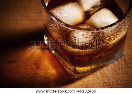 glasses from whisky on a wooden table - stock photo