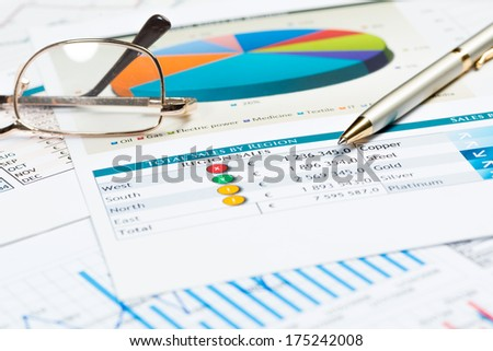 glasses, graphics and keyboard. business still life