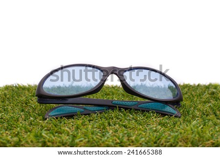 Glasses Isolated on green grass on white gackground