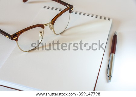 Glasses,Notepad And Pen