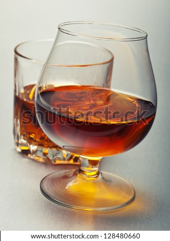 glasses of alcohol whiskey on white - stock photo