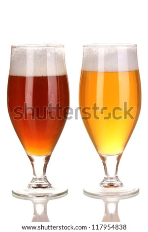 Glasses of beer isolated on white - stock photo
