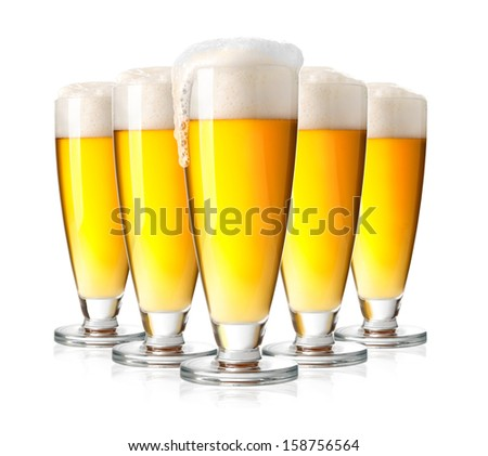 Glasses of beer isolated over white