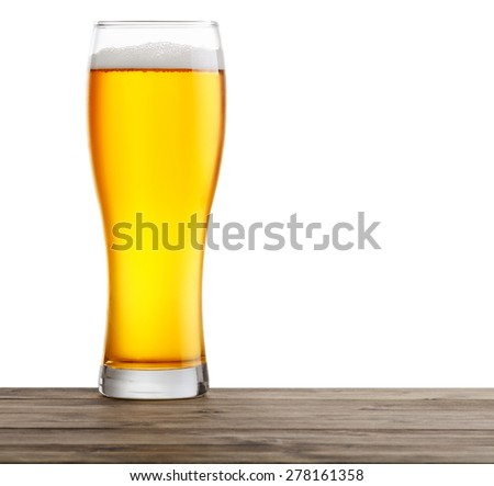 glasses of beer on a wooden table. Isolated on a white background. - stock photo