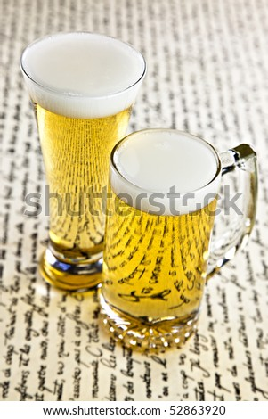 Glasses of Beer On White Parchment Paper