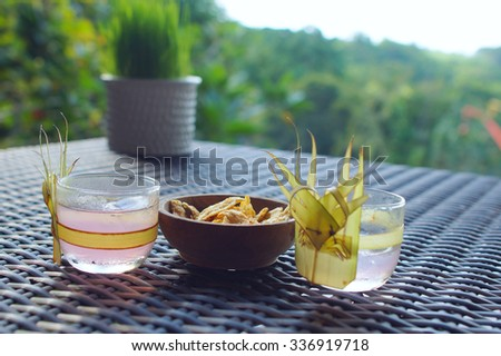Glasses of beverage with snack - stock photo