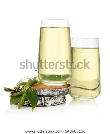 Glasses of birch sap, isolated on white - stock photo