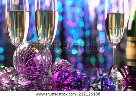 Glasses of champagne and Christmas ball - stock photo