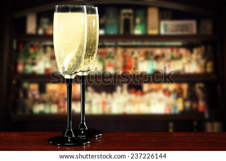 glasses of champagne and dark interior of bar in new year time  - stock photo