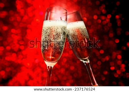 glasses of champagne and red space  - stock photo