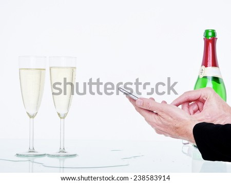 glasses of champagne and streamer tablet background - stock photo