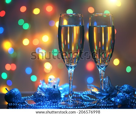 Glasses of champagne. background of lights