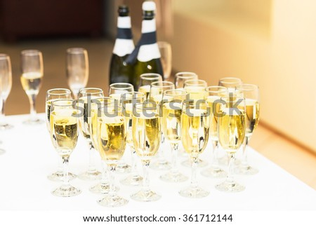 Glasses of champagne for a celebration on the table - stock photo