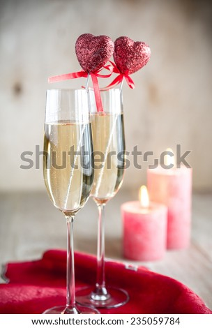 Glasses of champagne in candlelit on St Valentine's day - stock photo