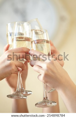 Glasses of champagne in female hands on a party - stock photo