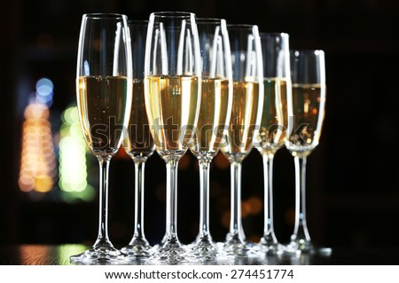 Glasses of champagne on bar background - stock photo