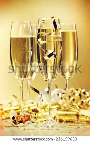 Glasses of champagne to bring in the new year - stock photo