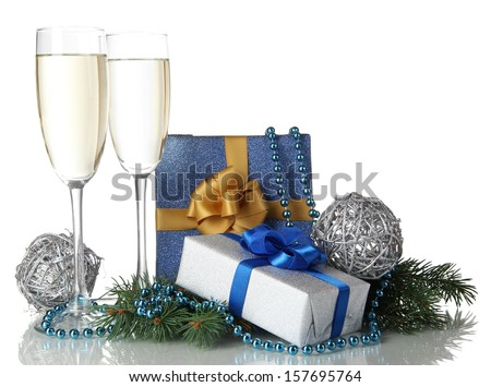 Glasses of champagne with gift boxes isolated on white - stock photo
