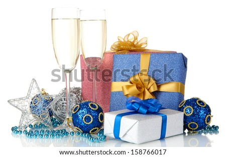 Glasses of champagne with gift boxes isolated on white