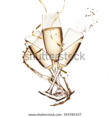 Glasses of champagne with splash, isolated on white background