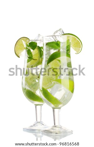 glasses of cocktail with lime and mint isolated on white - stock photo
