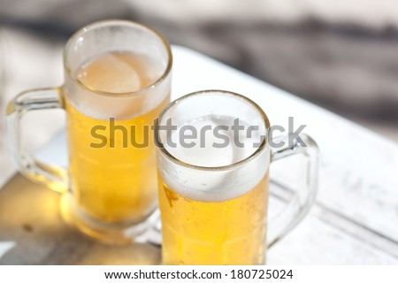 Glasses of cold beer on white wooden table, nobody - stock photo
