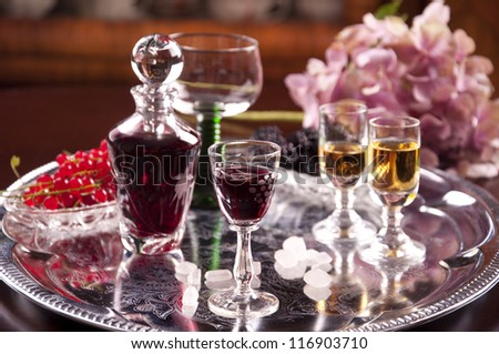 glasses of cordial and hydrangea - stock photo