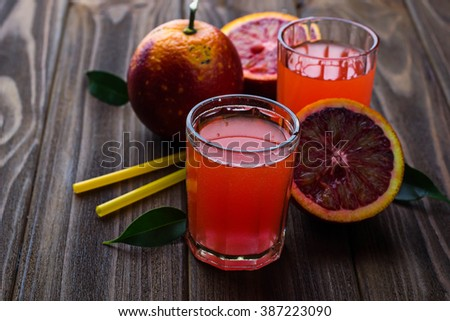 Glasses of fresh blood orange juice. Selective focus - stock photo