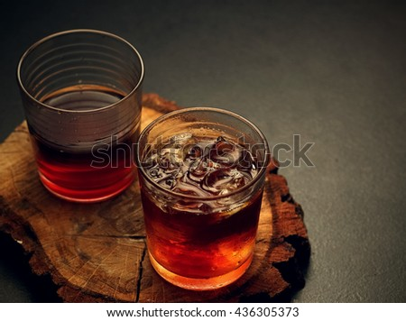 Glasses of hot and cold filter coffee on a wooden board. Toned image