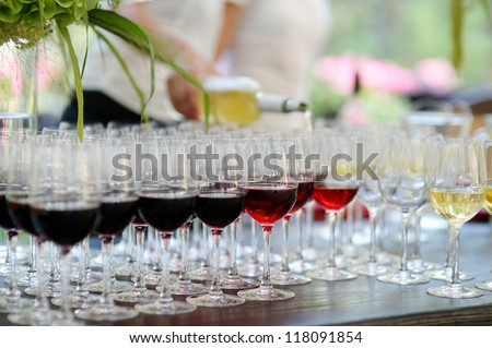 Glasses of red and white wine in a row