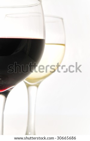 glasses of red and white wine shot in a studio