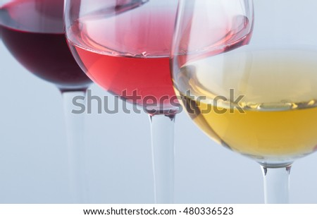 Glasses of red, white and rose wine