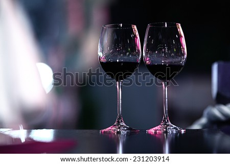 glasses of red wine at restaurant concept alcohol - stock photo