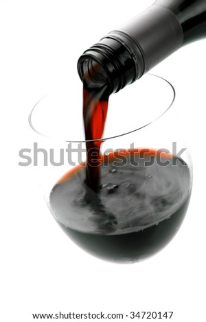 Glasses of red wine isolated against a white background