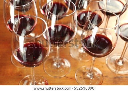 Glasses of red wine on bar counter