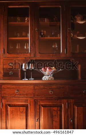 Glasses of red wine with apples in a bowl. Italian rustic style interior